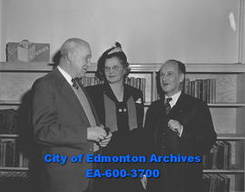 Cancer Society officials. E.F. McGarvey, Mrs. John Oliver and E.G. Wallbridge discuss 1950 campaign.