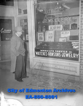 Surveying the scene of a robbery at Jack's Jewelry, 96 St. and Jasper Ave, is owner Jack Eur...