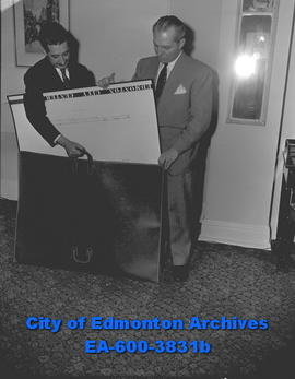 Architect A. Gordon Lorimer (left) with negotiator L.E. Detwiler and with a giant briefcase.