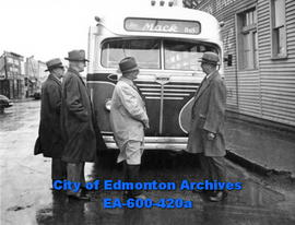 A Mack gasoline coach (bus) is demonstrated to civic officials: (L - R) E. I. Clarke, Thomas Ferr...