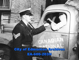 Edmonton Safety Council safety week awards: first winner Harry C. Smith is informed of his award ...
