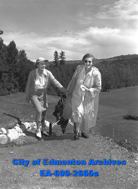 Alberta Women's Golf Championship at the Highlands.  Mrs. A. Matthew and Mrs. E.C. Perry climb a ...