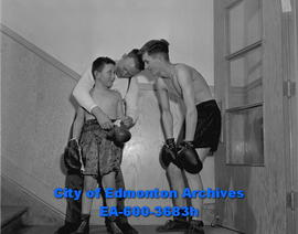 Boxing: trainer Bob Clarke with fighters Gordon Bussieres and Quintin Davidson.