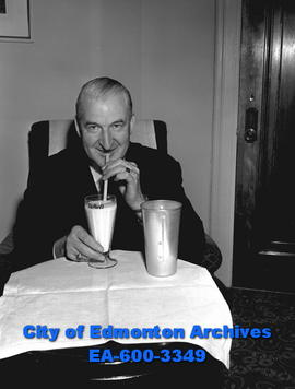 J.H. Stafford, president of the company which makes syrup is drinking a milkshake.