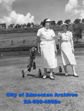 Ada Lent and Mrs. Pat Arnell on golf course.