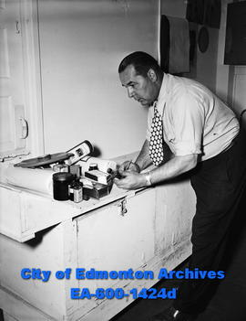 Doug Hardy, hockey coach of the Edmonton Flyers, with first aid supplies.