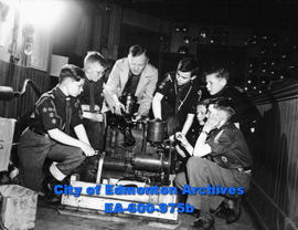 28th Edmonton Boy Scout Troop given motor instruction by master mechanic Harvey Holte. (L-R) Ken ...
