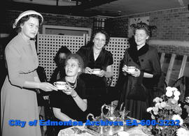 YWCA tea party. L-R: Mrs. John McGuire, Mrs. Stewart Gordon,Mrs. Carl Lang, Mrs. R.B. Wishart.