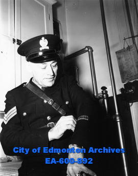 First policeman in Edmonton history to wear seven service bars representing 35 years of service: ...