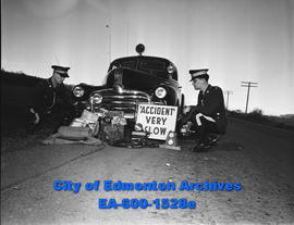 Car accident: RCMP officers with accident equipment.