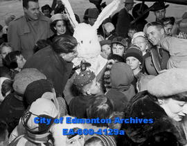 Easter Bunny greets kids.