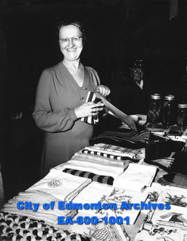 Blind woman, Mrs. J. M. Christopherson, operating a stall at the City Market.