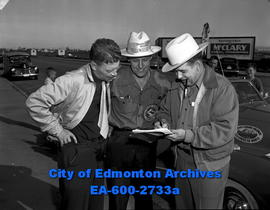 Yellowhead route car caravan. L-R: Lloyd Warner, Ed Olson and Reg Easton prepare to leave for Van...