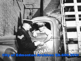 Edmonton Safety Council safety week awards: first winner Harry C. Smith's driver's licence is exa...