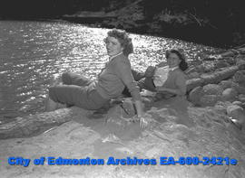 "Women's Page - ""Cottage Owners Flock to Country . . ."" Wilma Little and Lois Grant sit ..."