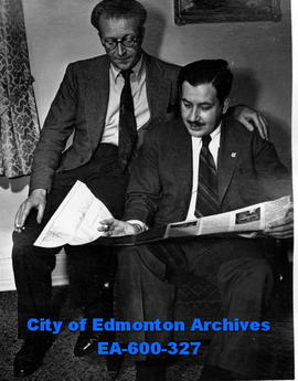Studying map of Canada: Norman Smart, assistant news editor of the London Daily Express and R. C....