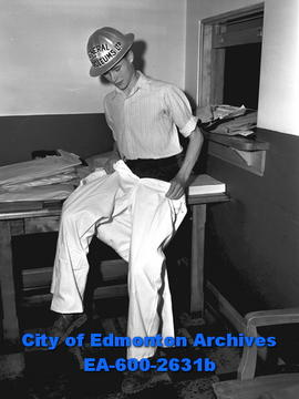 Boy scout dresses up in oilman overall and steel hat. - City of Edmonton  Archives 3633da951151