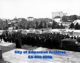 Members of United Mine Workers of America parade through city streets and demonstrate in front of...