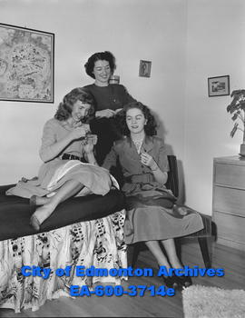 Women's Page: Girls of Beta Sigma Phi. Margaret Cunliffe, Dodie Derbyshire and Norah Moran prepar...
