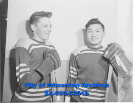 Juvenile hockey players (L-R): Jack Hunt, South Side; and Elias Yamauchi, South Side.