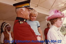 Assistant Commissioner Victor Seppala holding his son Doug Seppala at the official ceremonies of ...