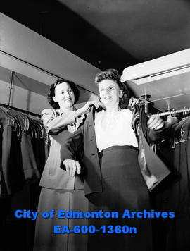 Anna Anholt tries on clothes at the Bay.  Saleswoman, Laurett Riopel, assists.