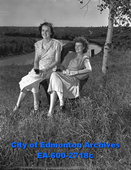 Women's Page - Summer Special. Mrs. Donald Marshall and Mrs. Ralph Hole relax by the Saskatchewan...
