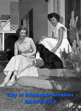 Anne Armstrong (L) and Pat McGinty (R) sitting on house steps with dog.