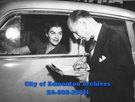 Edmonton Safety Council safety week awards: Mrs. Clarence Kube is informed of her award by Paul L...