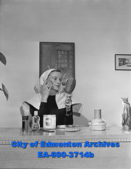 Women's Page: Girls of Beta Sigma Phi. Betty Hall applies facial cream.