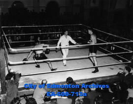 Amateur boxing: (L-R) Joe Parker, Referee Johnny Smith and Hughie MacDonald.