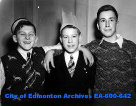 Annual pre-Christmas banquet for delivery boys and street sellers of The Edmonton Bulletin: (L-R)...
