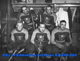 1934 EAC hockey team at exhibition game with 1939 Capitols hockey team: (L-R, B-T) Morey Rimstad,...