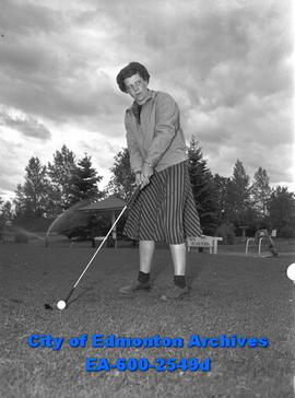 Women s Golf Feature  Mrs. Ernest Robinson prepares to shoot. - City of  Edmonton Archives 3fb48fe57f39