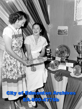 Camrose Junior Beef Club trophies are displayed by sisters Marg, and Helen Smith (R) of Bittern L...