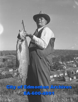 Record white fish is held by Det. Sgt. W.A. Smith. The fish was caught at Lesser Slave Lake by Gl...